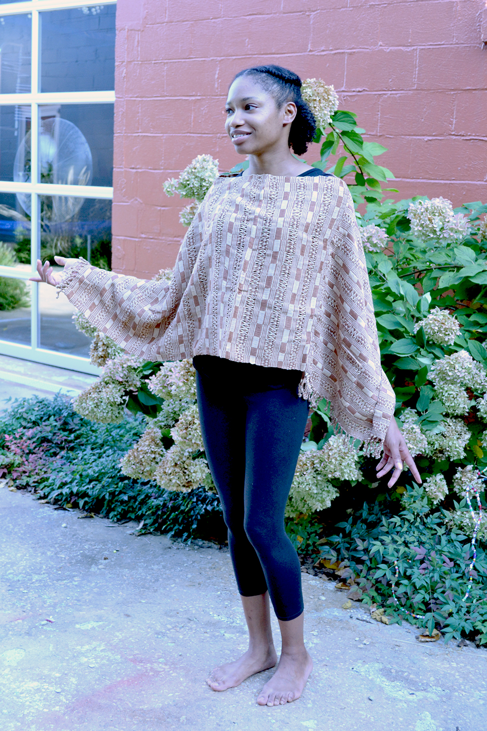 San Juan Poncho in Tan, worn in boatneck style