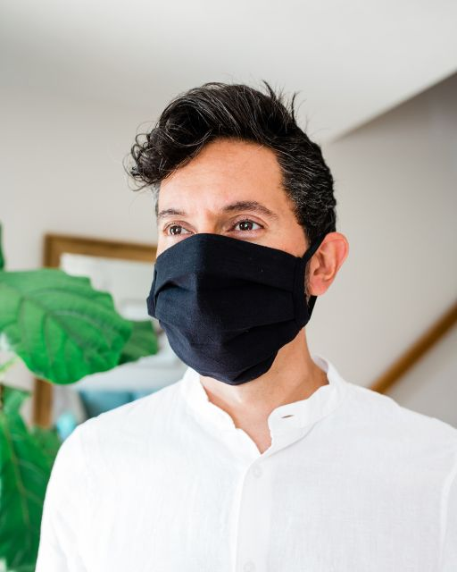 Solid Black pleated face mask. Handmade Fair Trade