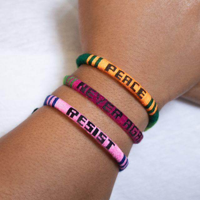 Peace Resist Never Again woven friendship bracelets fair trade