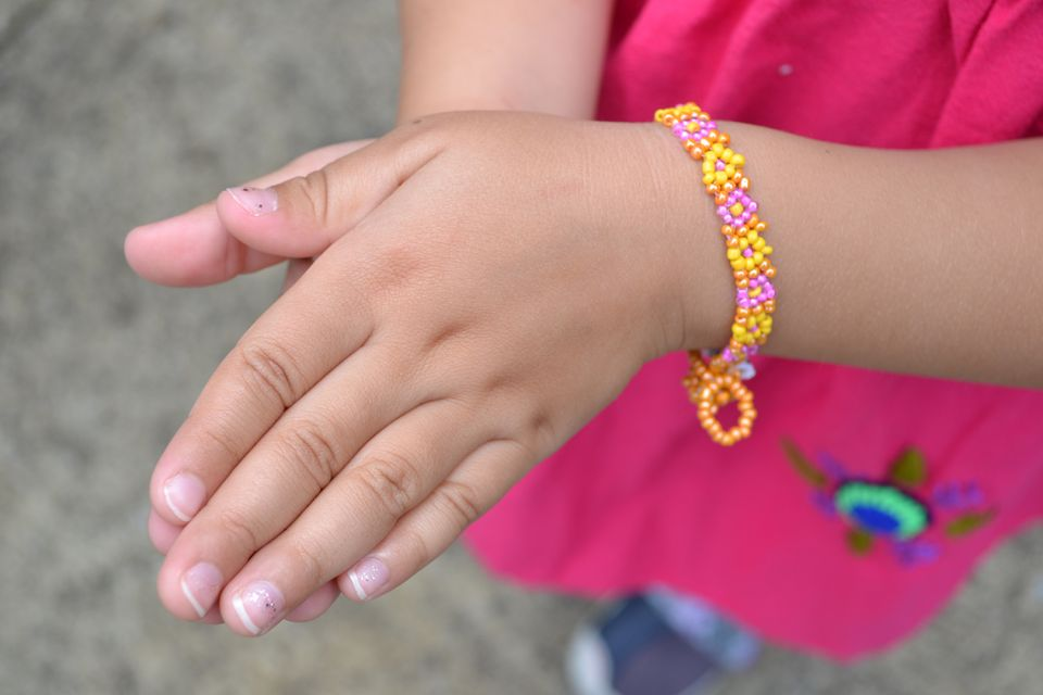 Hand beaded daisy chain fair trade bracelet for kids and tweens